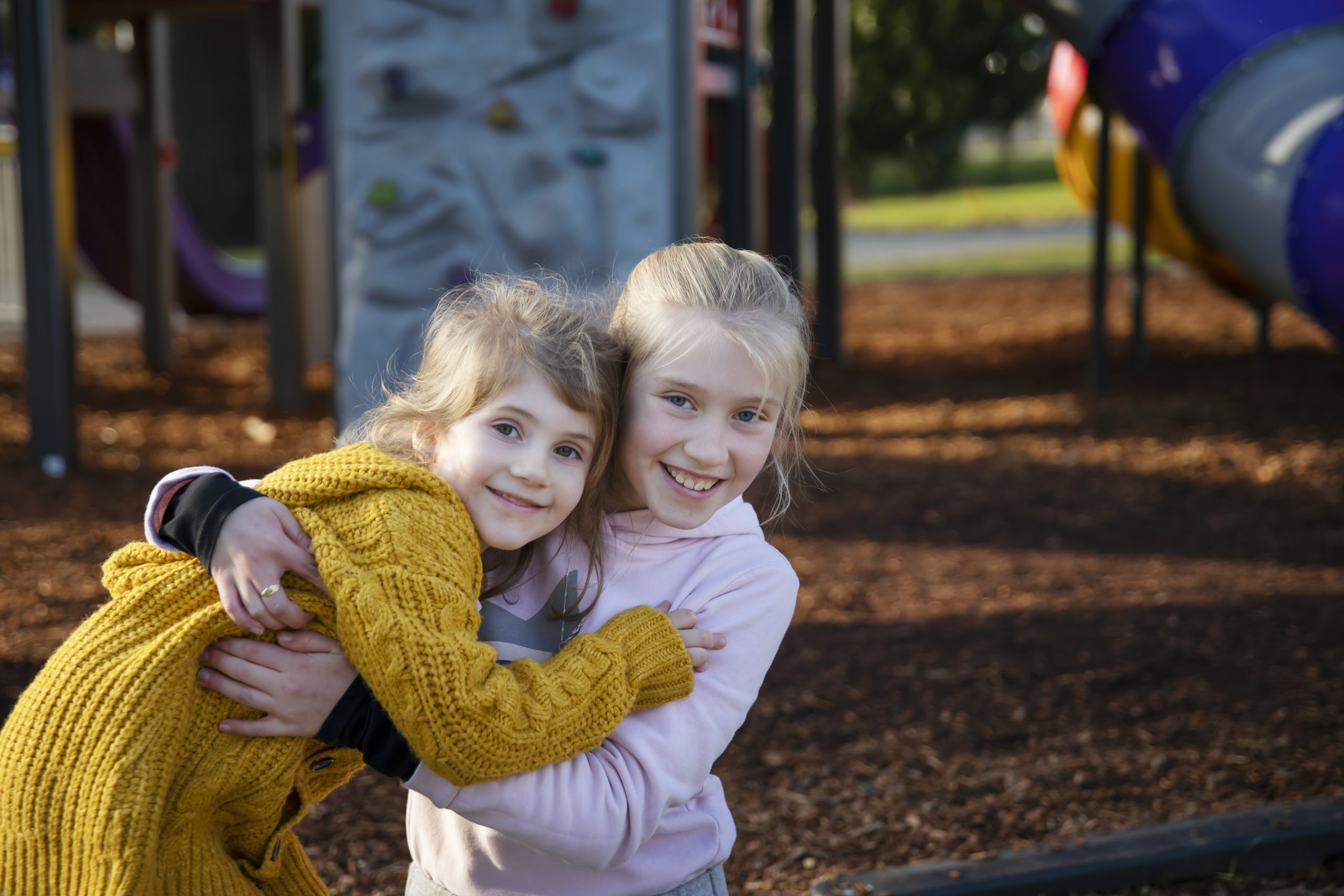 Violet & Madelyn Richardson enjoying a sunny day in Coronation park during winter school holidays